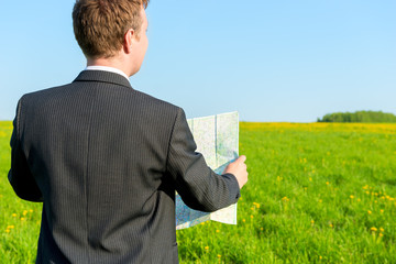 strayed man seeking to map the way in the field