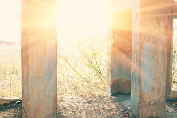 Sun in door of demolished building