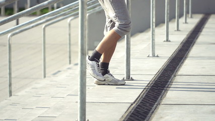 Man resting after run on stairs, super slow motion