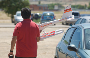 A man carries his RC Hydroplane