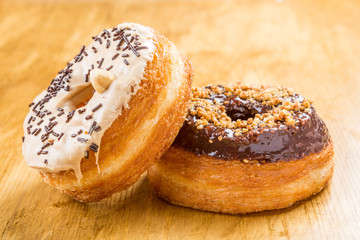 two Cronuts on wooden table