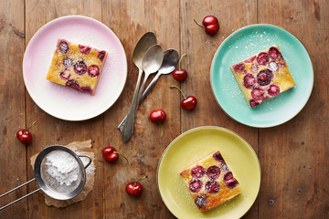 Cherry clafoutis pie on wooden table