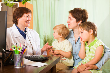 mother with  children and friendly pediatrician doctor