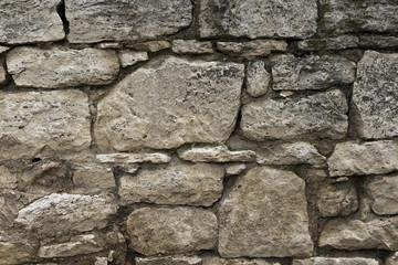 Old wall of travertine (calcareous tufa)
