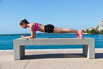 Hispanic woman doing a pilates plank for fitness