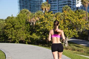 Woman running along a path