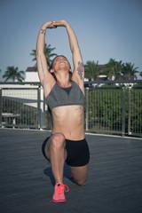 Hispanic woman doing yoga outdoors - filter applied