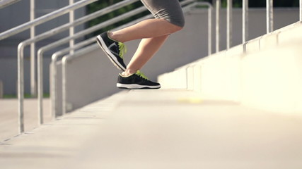 Woman legs jogging up the stairs