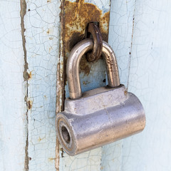 Old metal padlock on the iron gate