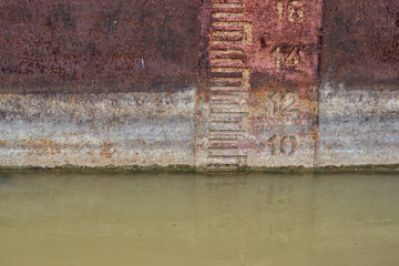 Waterline on old and rusty ship