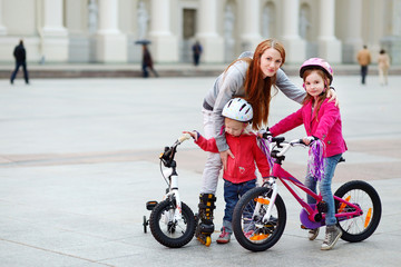 Young mother with kids in a city