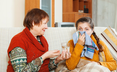 Mature woman caring for  adult daughter has cough