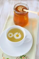 Herbal tea and  a jar of honey