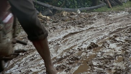 Motorbike through mud. cambodia