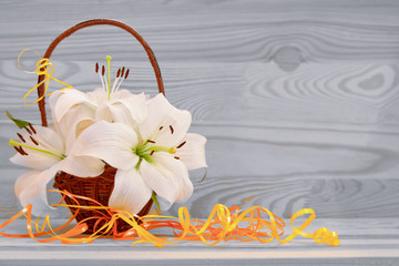 White lily solated on wood background.