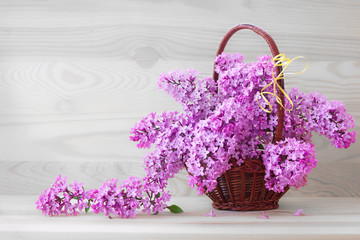Lilac bouquet isolated on wood background.