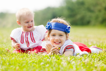 Smiling children in ukrainian folk clothes