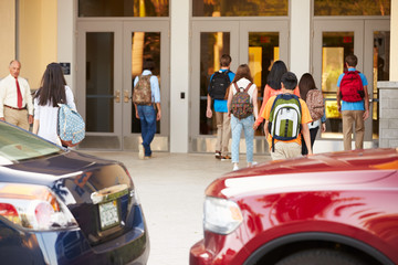High School Students Being Dropped Off At School By Parents