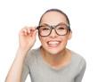 asian woman in adjusting eyeglasses
