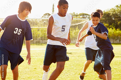 canvas print picture Members Of Male High School Soccer Playing Match
