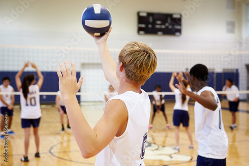 High School Volleyball Match In Gymnasium - 66165223