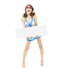 happy sunny bikini girl standing and holding a board