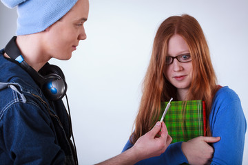 Boy showing marijuana joint to girl