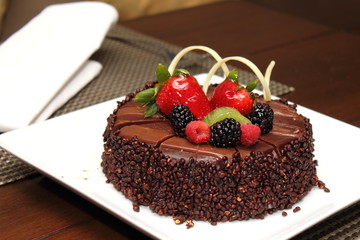 Chocolate cake with fresh fruit decoration.