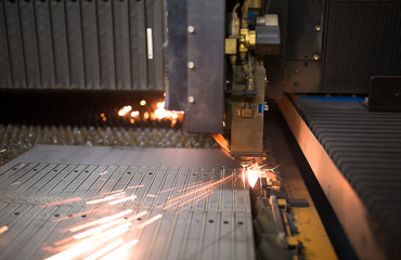 Industrial Laser during Cutting Metal Works at Factory Workshop