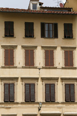 Typical facade with windows of Tuscan architecture. florence, It