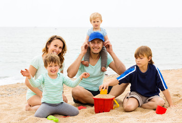 Positive parents with kids on vacation