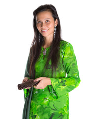 Asian Malay woman in a green dress with a brown purse