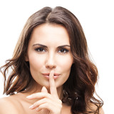 Woman with finger on lips, on white
