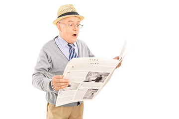 Surprised senior gentleman reading the news