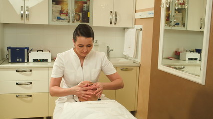 Facial treatment with massage therapist during seance at beauty