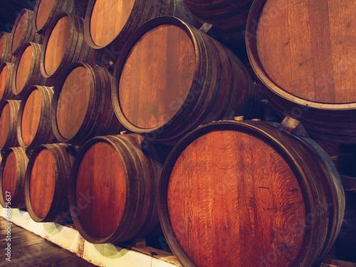 Row of wooden barrels of portwine, Porto, Portugal © sergeialyoshin