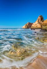 Blurred sea waves on the sea landscape. Portugal, Albufeira.