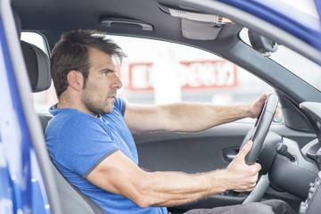 Man drives car fast.