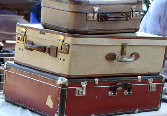 three old leather suitcases  at the market of vintage and retro
