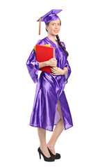 Woman in graduation gown holding books