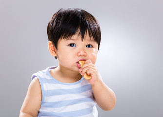 Little boy eat biscuit