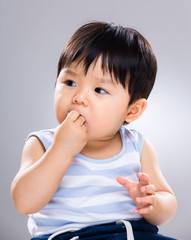 Little boy eat cookie