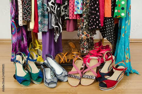 Leinwanddruck Bild Closeup on summer sandals in a wardrobe. Tidy dressing closet.