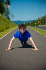 Teenage boy doing press-up