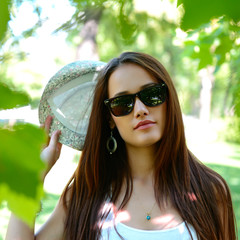 fashion girl outdoor portrait, young woman walking in summer par