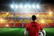 Composite image of spain football player holding ball