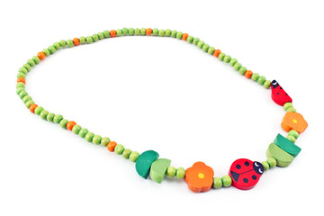 Wooden beads  necklace with ladybug isolated on white