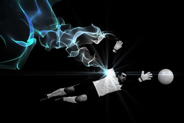 Composite image of goalkeeper in white making a save