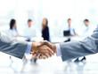 Leinwanddruck Bild - Close up of businessmen shaking hands