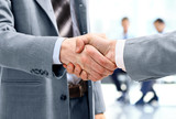 Fototapety Close up of businessmen shaking hands